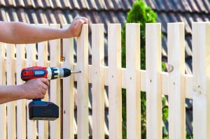 Man building fence
